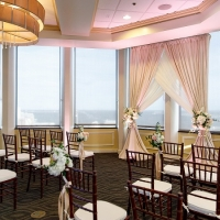 Citrus Club Ceremony Set up with Blush Pink Uplighting