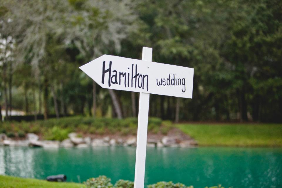 """Welcome sign pointing guest toward the venue that says """"Hamilton Wedding"""""""
