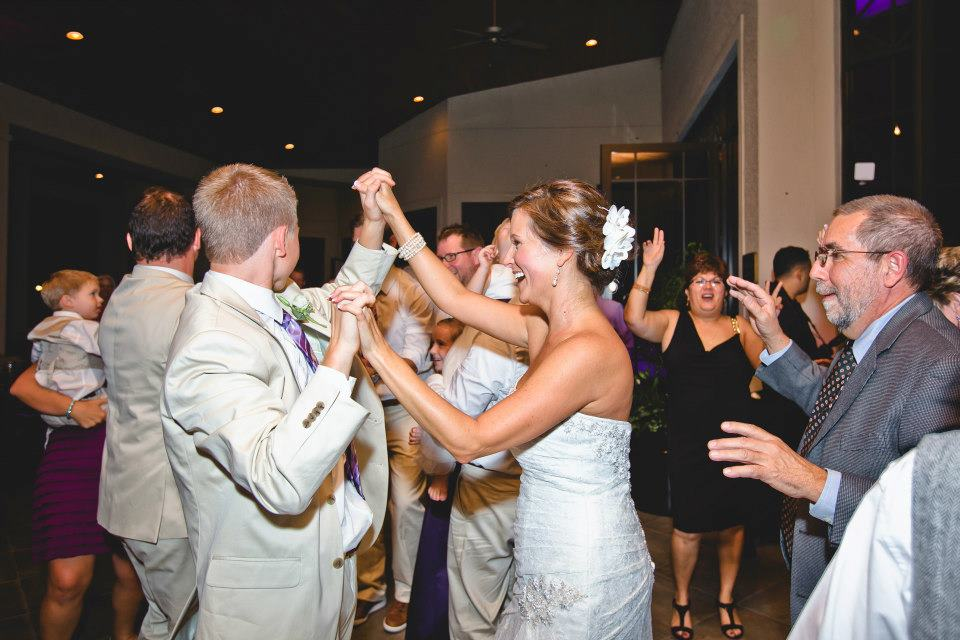 Danced floor packed with bride dancing with a groomsman