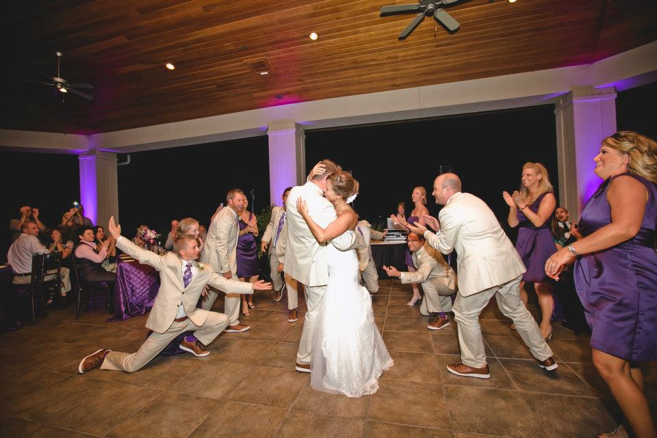Bride and Groom dancing in the middle of dance flow with friends and family surrounding them