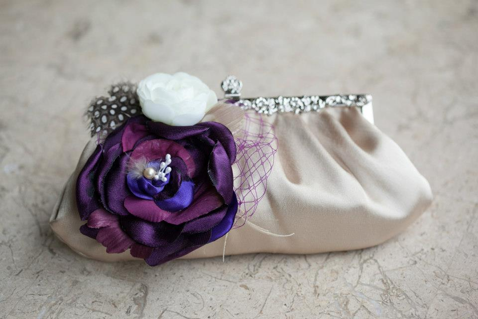 Vintage purse twith a purple flower that the bride carried