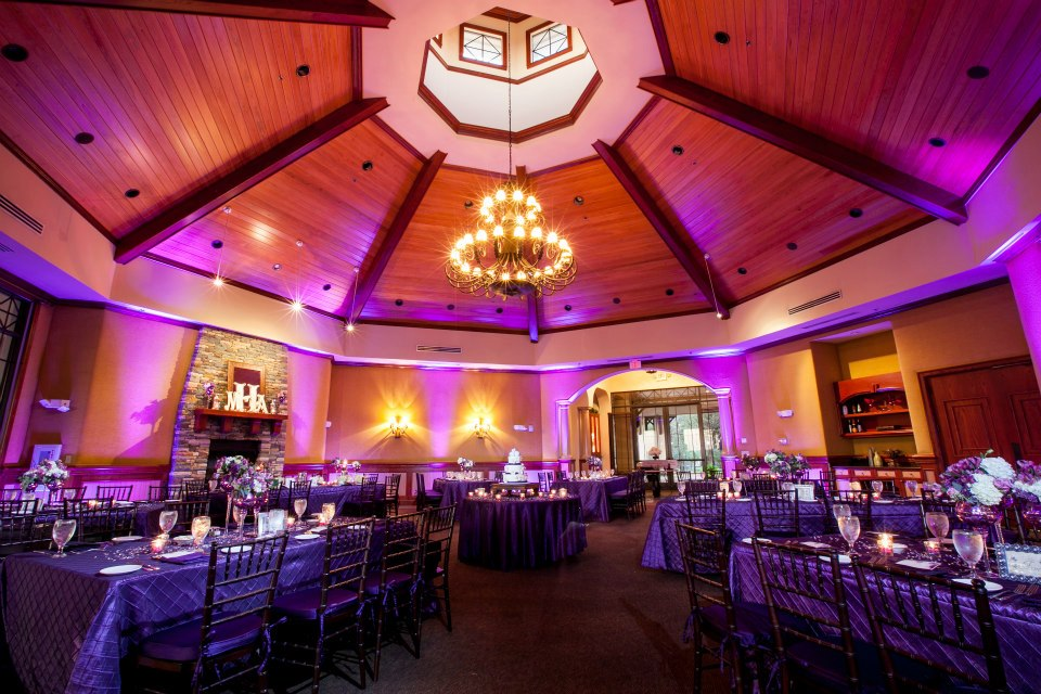 Room shot of the Red Tail Country club with purple uplights done by Our Dj Rocks