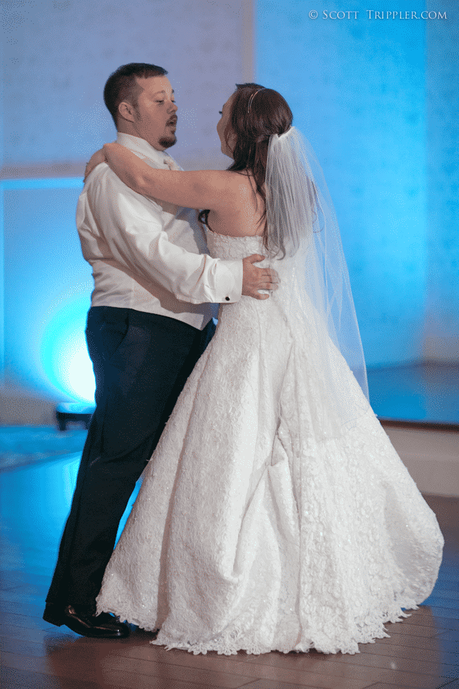 bride and grooms first dance with blue uplighting at lake mary event center with orlando wedding dj our dj rocks