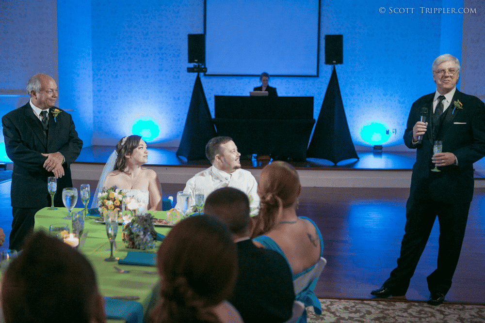 champagne toast to the bride and groom with blue uplighting at lake mary event center with orlando wedding dj our dj rocks