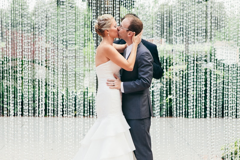 """Bride and groom kissing after saying """"I do"""""""
