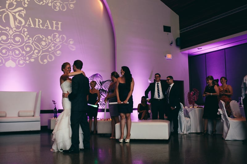 bride and grooms first dance at the winter park civic center with purple uplighting and a customized monogram done by Our Dj Rocks