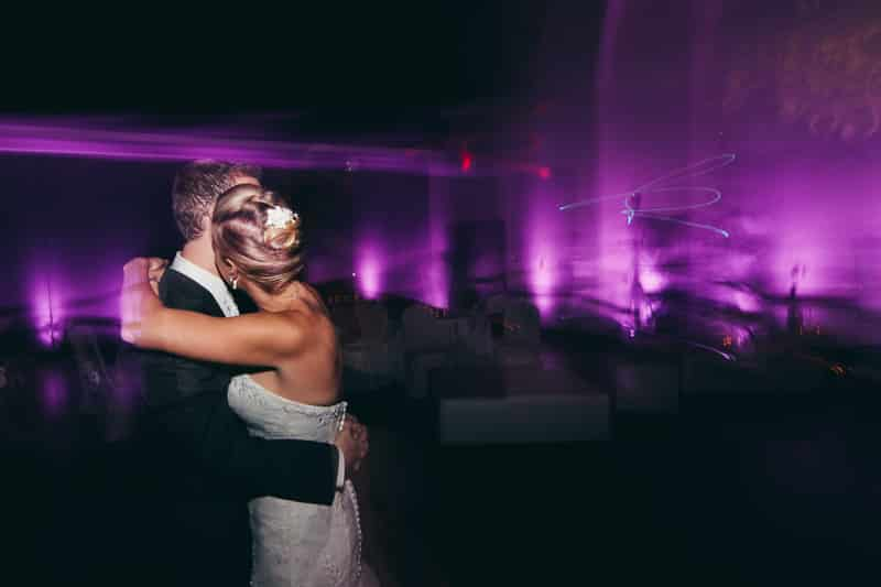 Bride and Groom sharing a solo last dance at Winter Park Civic center with purple uplighting, provided by Our DJ Rocks