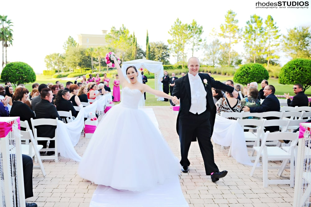 Bride and groom walking back down the aisle; recessional