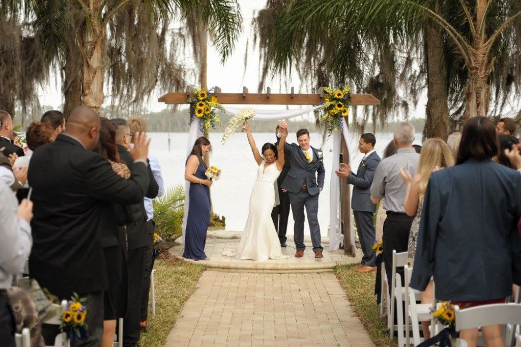 Bride and Groom at the Alter at Orlando Wedding Venue Paradise Cove