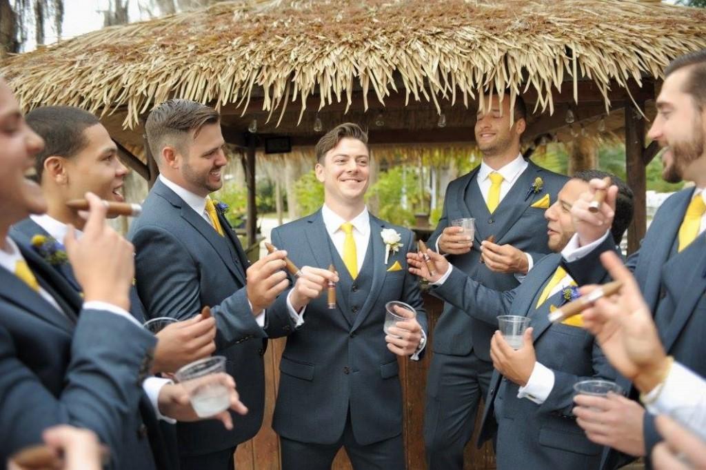 Groomsmen enjoying cigars at Orlando wedding venue paradise cove