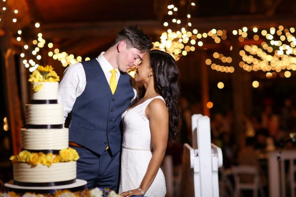 bride and groom about to cut their cake at orlando wedding venue paradise cove