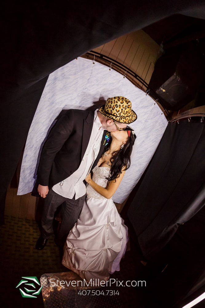 Bride & Groom with taking a photo with Orlando Wedding Photobooth Rentals Photobooth Rocks
