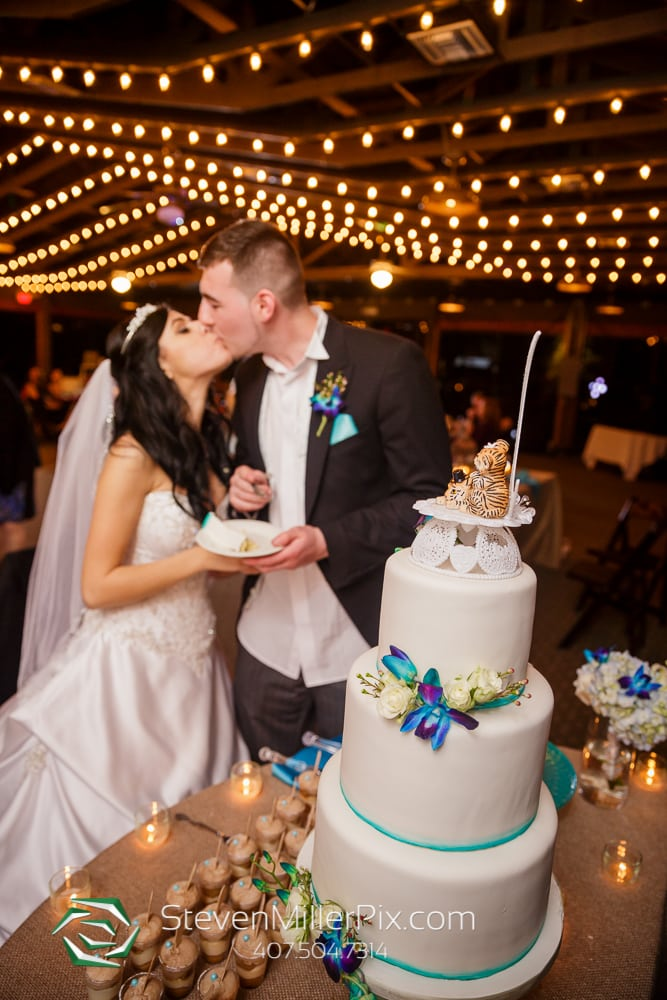 Bride & Groom cake cutting at Orlando Wedding Venue Marina Del Rey At Mission Inn