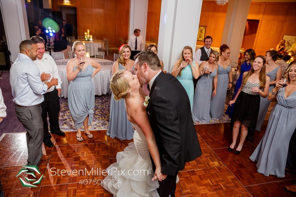 bride and groom kissing at orlando wedding venue Hyatt Regency Grand Cypress