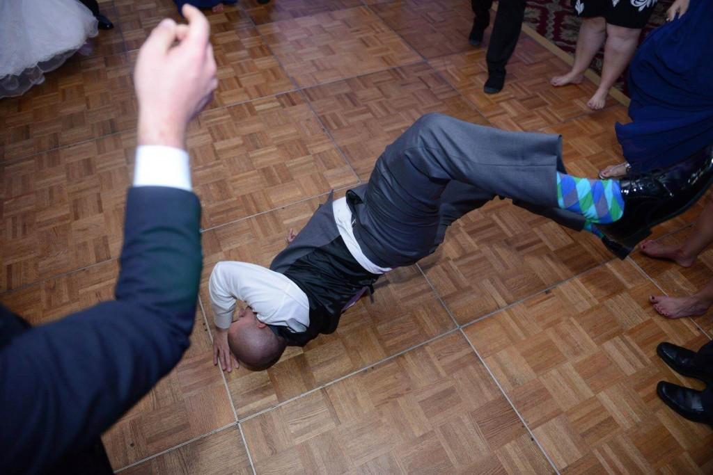 Break dancing at a wedding. Cool socks.
