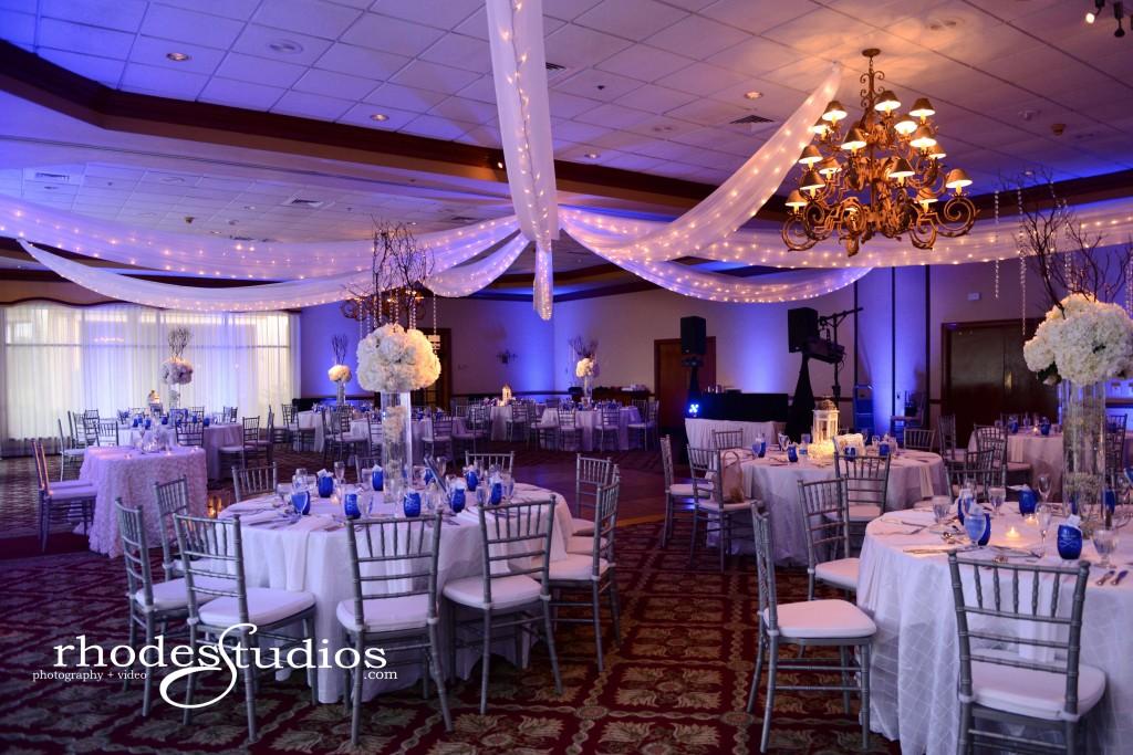 mission inn resort wedding snow winter wedding with blue uplighting and snow falling