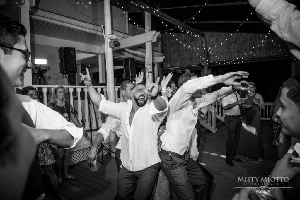 Dancing on dance floor at Paradise Cove. Market lighting.