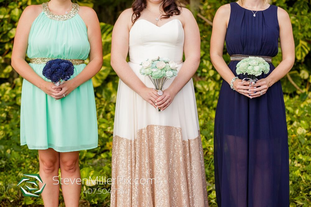 steven miller photography Green and blue wedding flower bouquet. Sparkly wedding dress. Green dress. Navy blue dress.