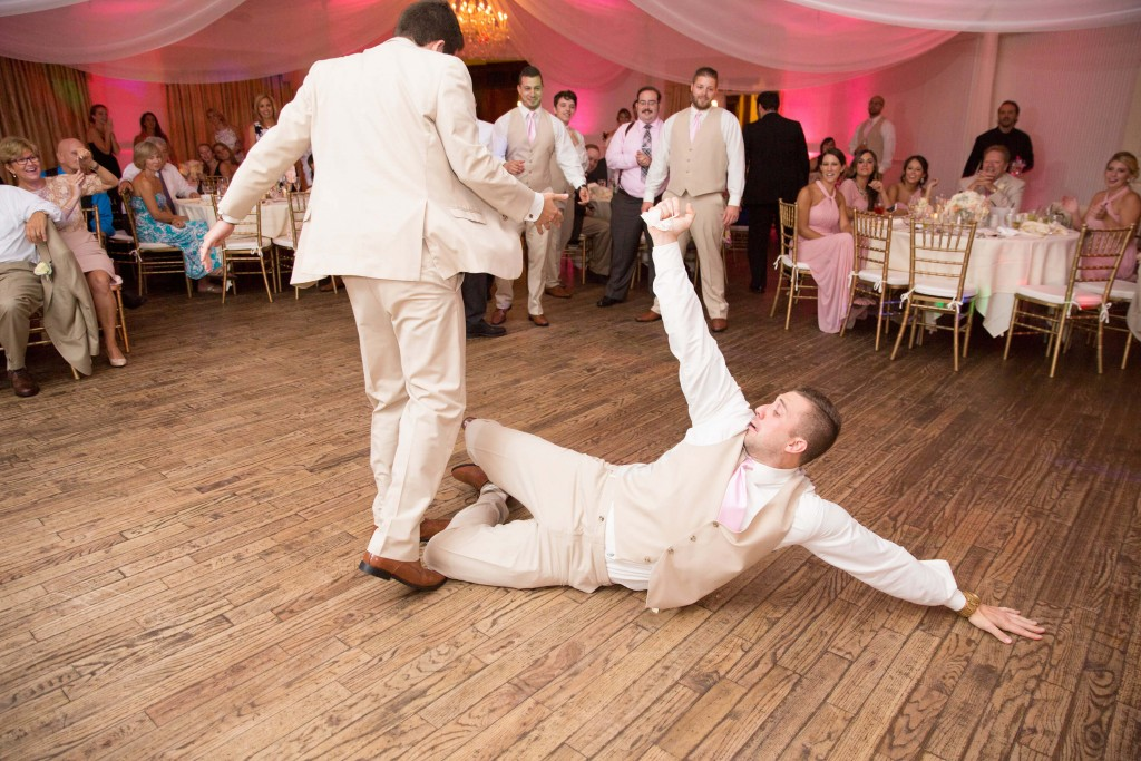 Pink uplighting. Break dancing at wedding. Tan tuxedo.  Drapery at wedding.