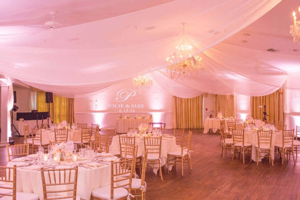Blush pink wedding. Light pink uplighting. Wedding drapery. Wedding gobo.