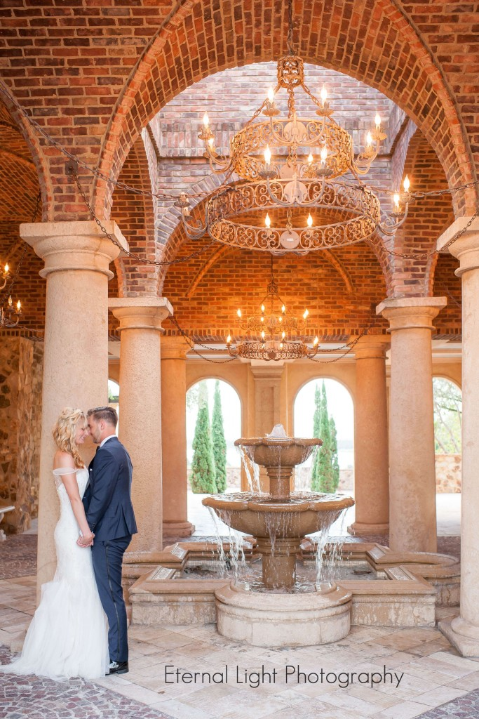 Bride and groom. Wedding at Bella Collina. Fountain. Chandelier outside. Eternal Light Photography.