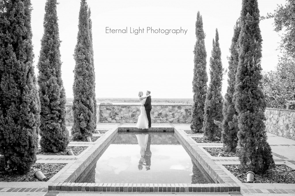 Wedding at Bella Collina. Wedding photo. Bride and groom by water. Outside wedding.