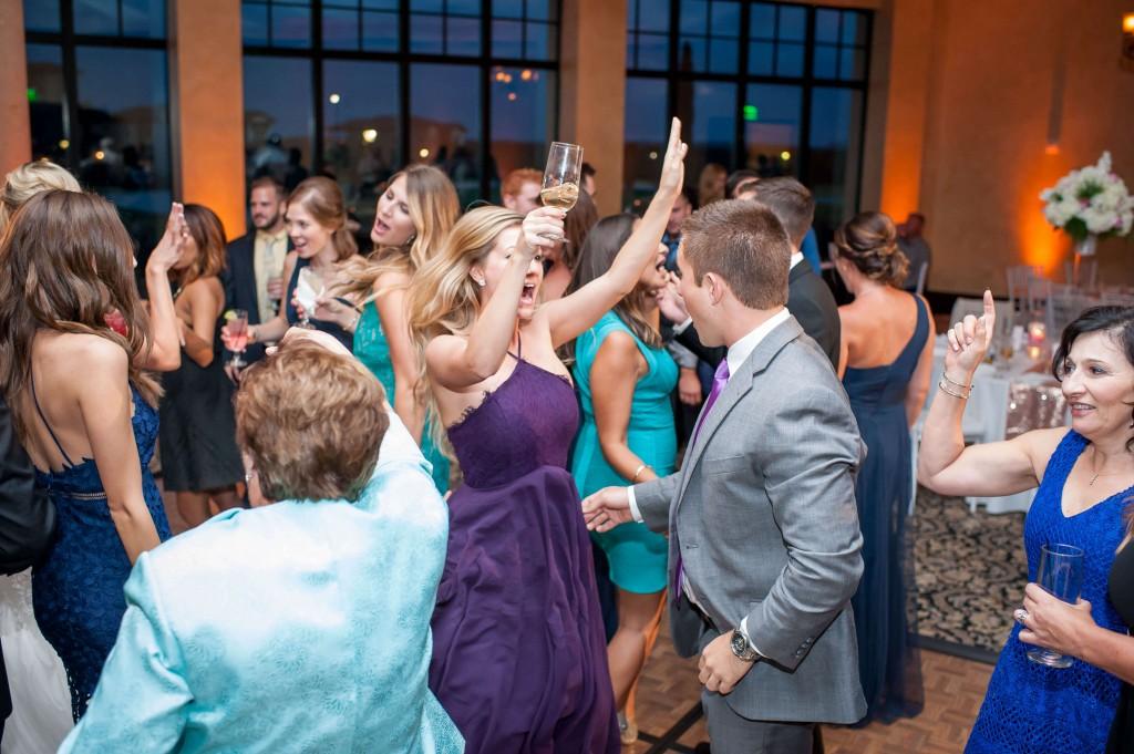 Dancing at wedding. Amber uplighting. Wedding at Bella Collina.