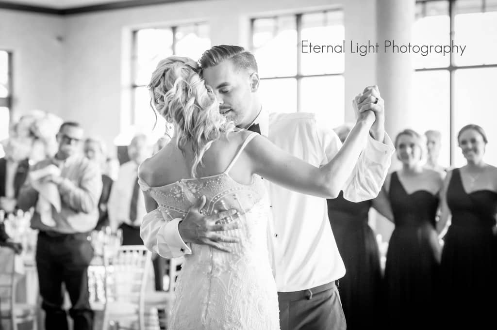 Bride and groom first dance. Wedding hair style. Bride and groom dancing.