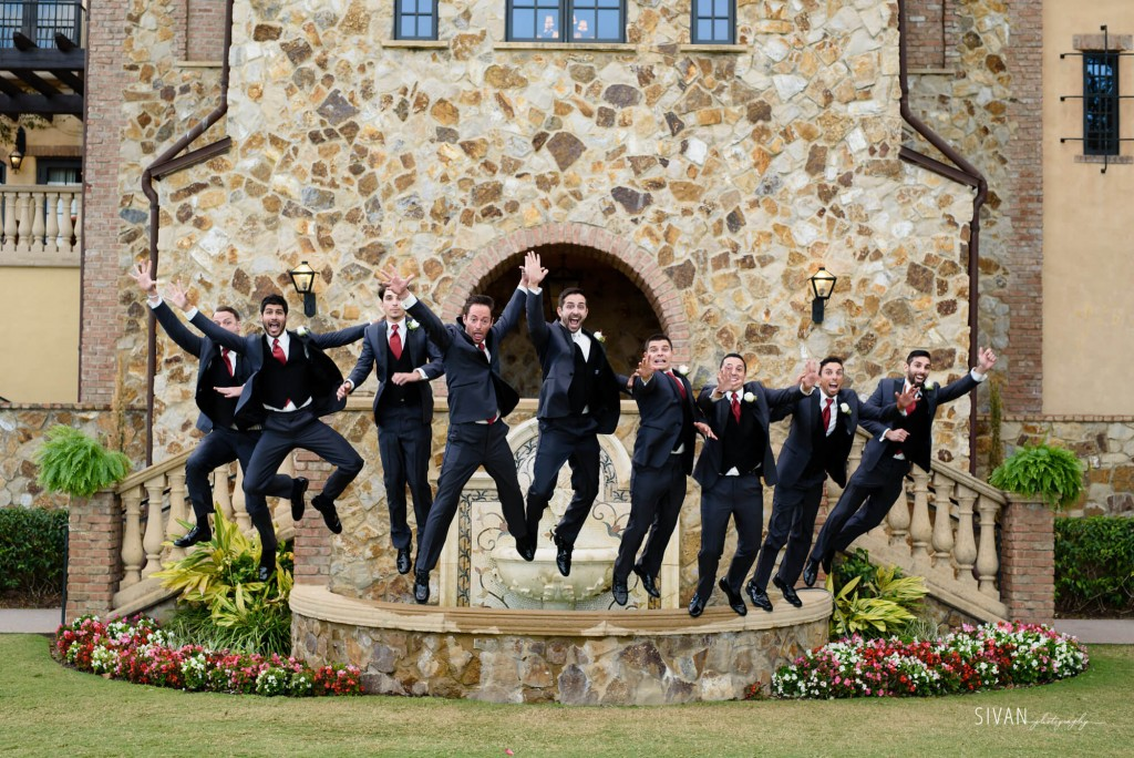 Groomsman jumping in air at Bella Collina. Funny wedding photo.