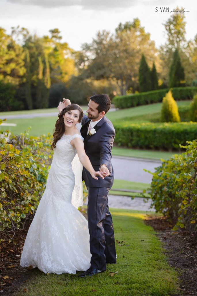 Bride and groom at Bella Collina. Cute wedding photo. Lace trumpet wedding dress. Outdoor wedding photo.