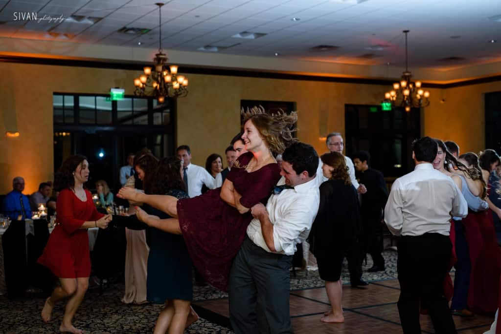 Swing dancing at wedding at Bella Collina with amber uplighting