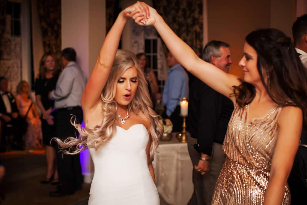 Bride dancing at wedding. Wedding dress. Gold sparkly dress.