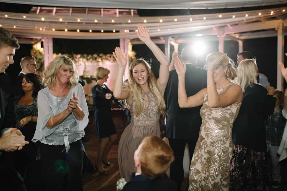 cypress grove wedding reception dancing with blush pink uplighting in background