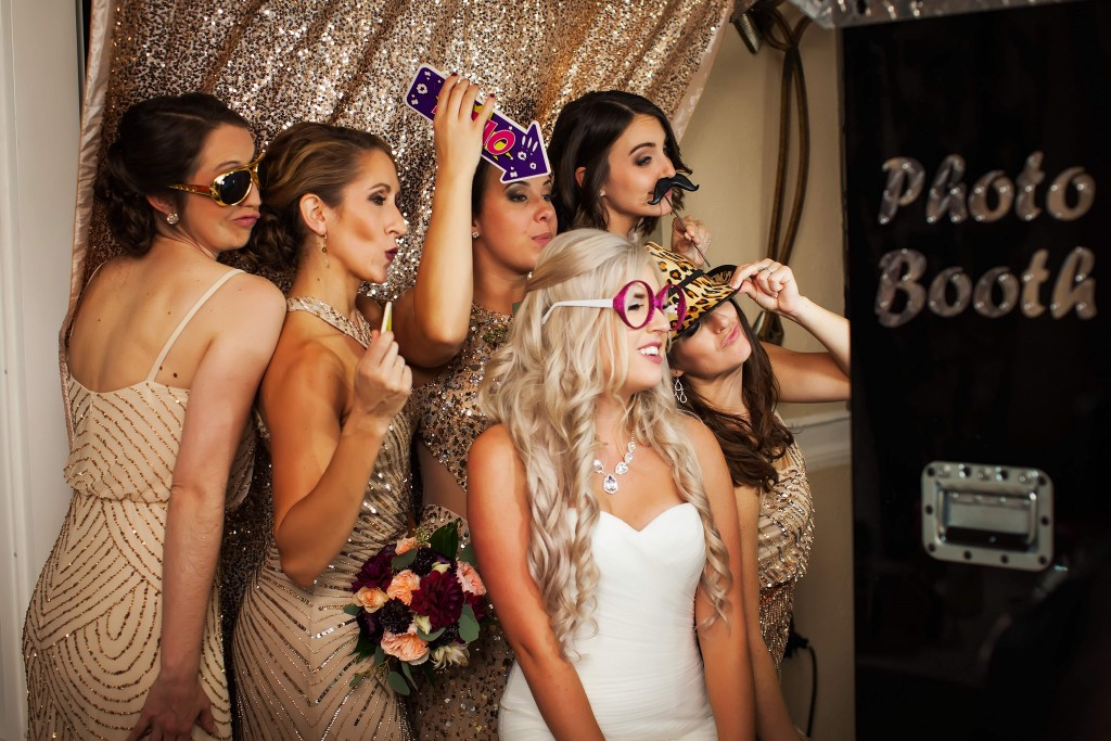 Photo booth at wedding.  photo booth orlando don cesar hotel. Gold sparkly photo booth backdrop