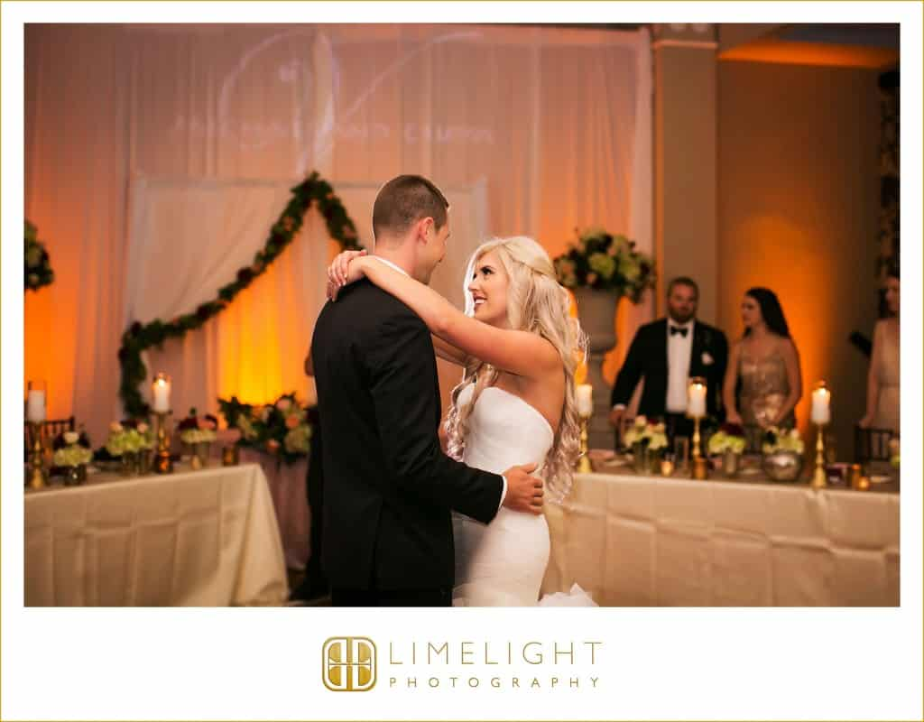 Amber uplighting. wedding at don cesar hotel st pete. Bride and groom first dance. Wedding gobo.