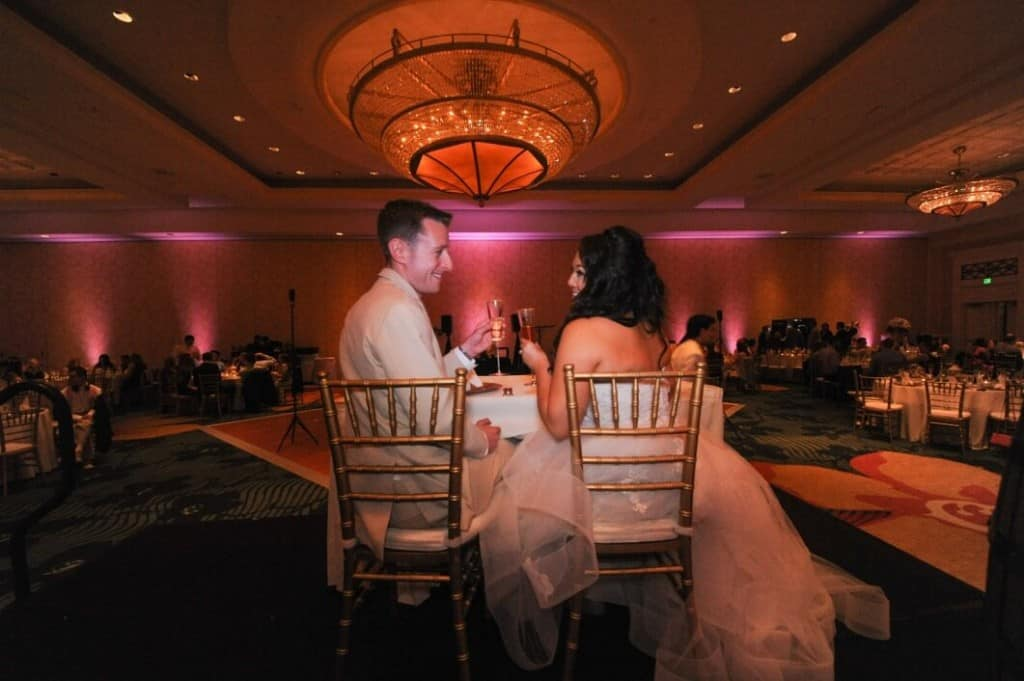 orlando wedding dj at Omni Champions Gate with chandilier and pink uplights in background