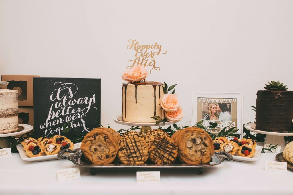 Same sex orlando wedding cake with happily ever after topper, cookies, and pastries