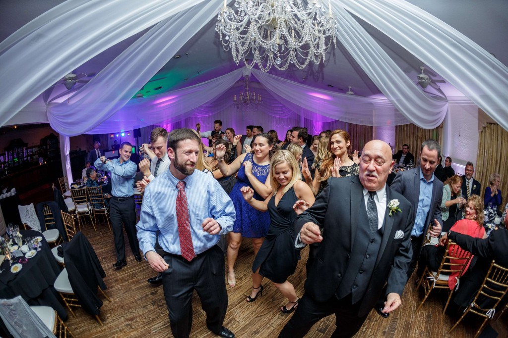 Highland Manor wedding reception dancing with draping and white and purple uplights
