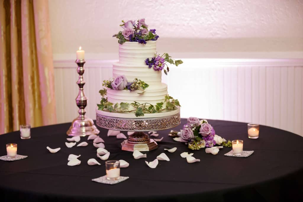 Wedding cake with purple flowers at Highland Manor wedding