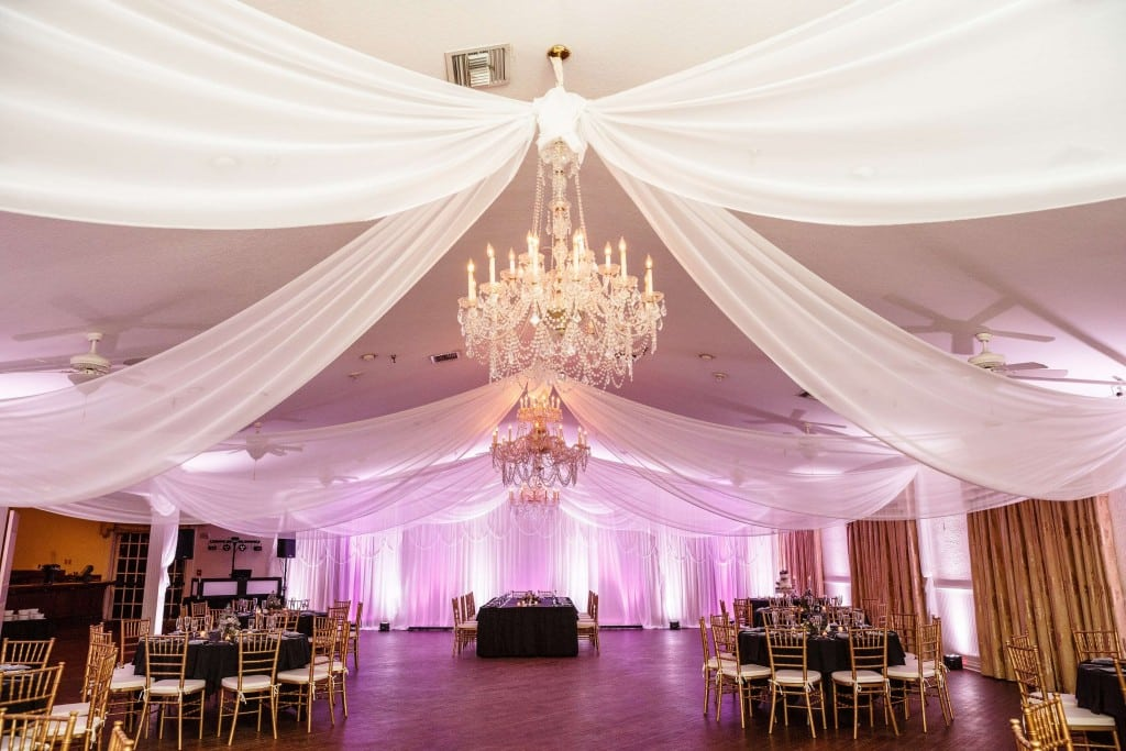 Highland Manor wedding venue with draping and white and purple uplights