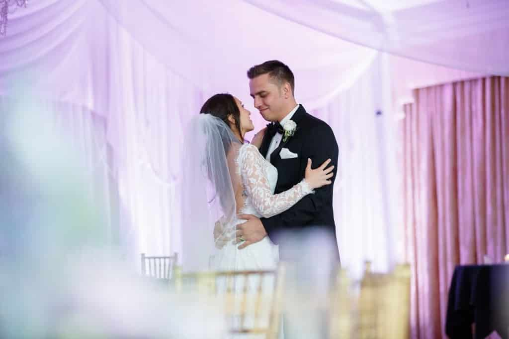 Highland Manor wedding bride and groom first dance with draping and white and purple uplighting