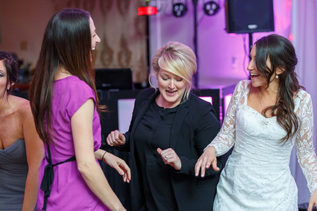 Our DJ Rocks founder, Kristin Wilson, dancing with bride and guests at Highland Manor wedding with purple uplighting