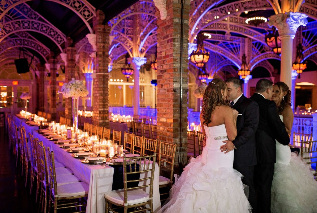 Orchid Garden Wedding Bride and groom with royal blue uplighting