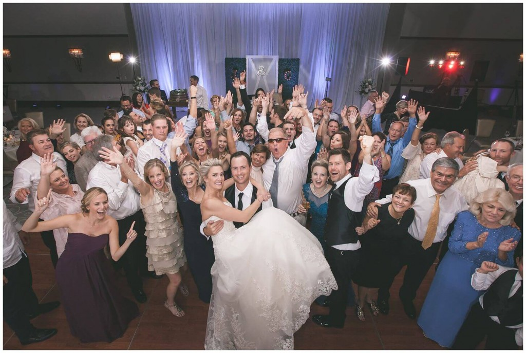 Alfond Inn wedding reception group photo with purple uplighting in background