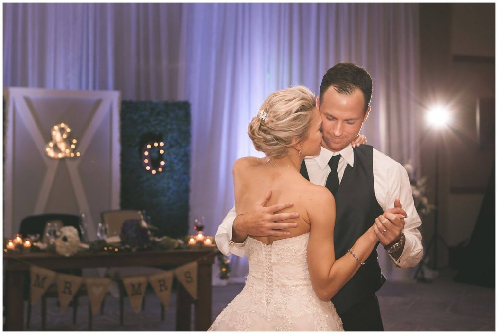 Alfond Inn wedding couples first dance with purple uplighting in background