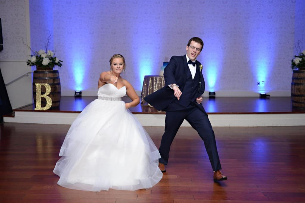 Lake mary events center wedding reception bride and groom dancing on dance floor with royal blue uplighting
