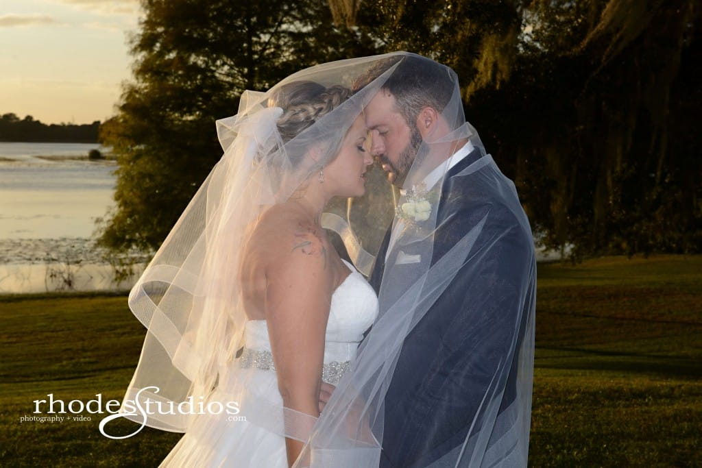 Lake mary events center wedding bride and groom with vale over their heads