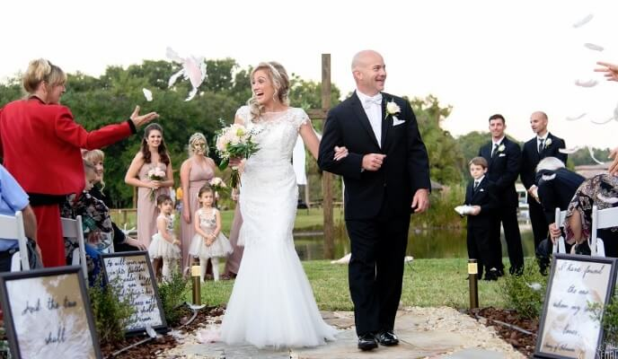 Private residence outdoor tent wedding bride and groom walking down aisle outdoors