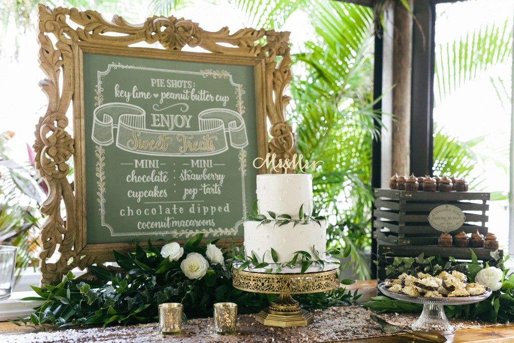 Paradise Cove Wedding cake setup with cake topper and gold cake holder