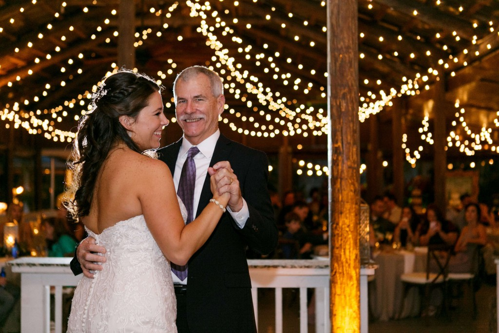 Paradise Cove Wedding father daughter dance with amber uplighting and market lighting in background
